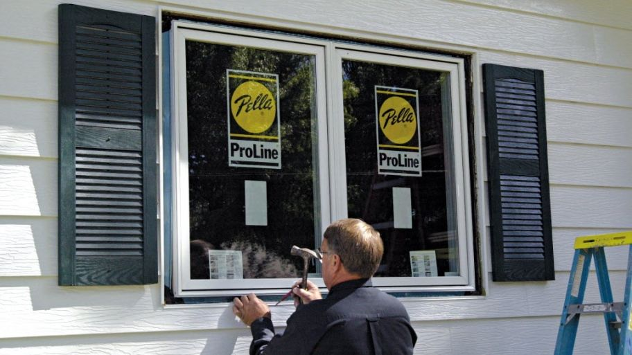 new house windows cost daneville window man installing window how much does window replacement cost home renovation pinterest