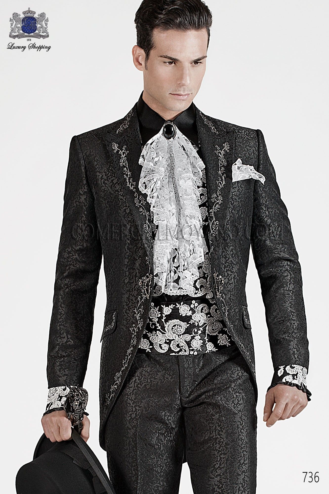 Italian bespoke black brocade short frock coat with silver floral embroidery and peak lapel. Silver embroidery on the front, rear, lapel, collar and pocket flaps, style 736 Ottavio Nuccio Gala, 2015 Baroque collection.