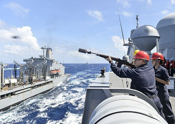 Petty Officer 2nd Class Wayne Moore fires the shot line to the Military  Sealift Command (MSC) fleet replenishment oiler USN… | Navy ships, Blue  water navy, Navy day