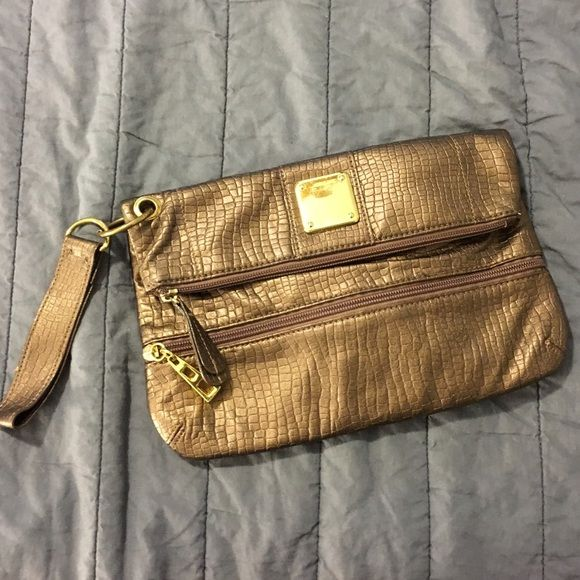 Bronze Faux Leather Clutch/Wristlet Clutch/Wristlet in Bronze Faux Leather. Zip top to keep your things secure, outer zipper pocket. So cute for going out! Offers & Bundles welcome! Daisy Fuentes Bags Clutches & Wristlets
