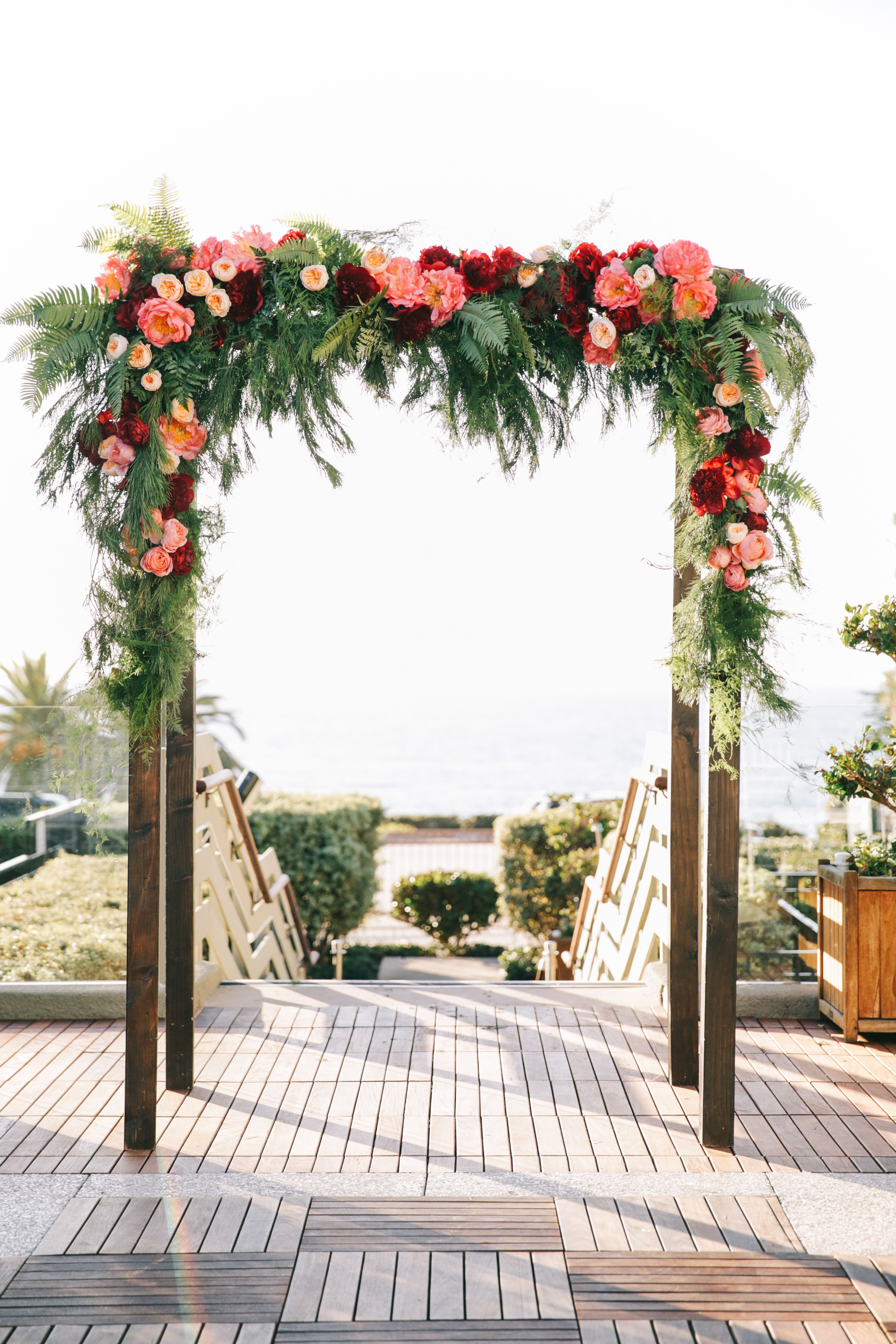 Burgundy and pink floral arch with garden roses for Arch ideas for home