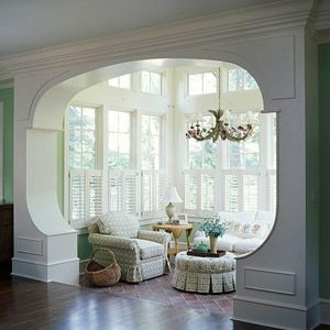 guess there would be a lot of arches in my dream home. I am seeing a pattern here!  Love this sunroom!  I love the way it isn't a closed off portion of the home....