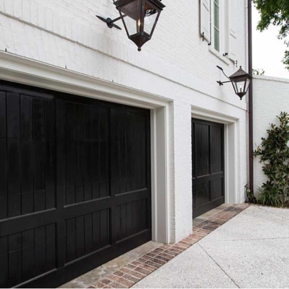 Grey house black garage doors - Black Garage Doors Monochrome Traditional