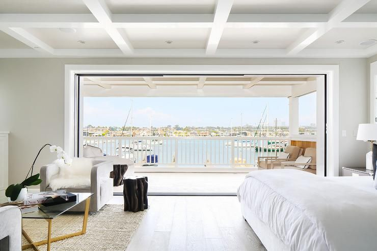 Best Chic Beachside Bedroom Boasts A Coffered Ceiling Placed 400 x 300