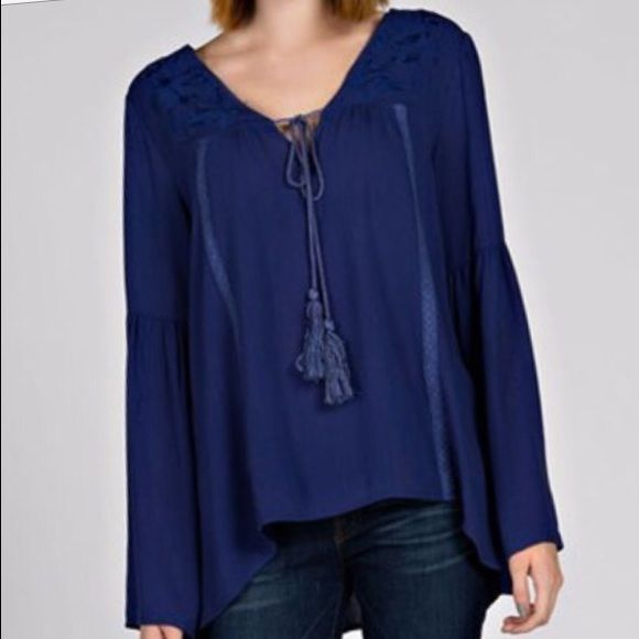Bohemian top 100% rayon. C neck with tie. Gauze texture. Slight bell sleeve. Embroidered detail   ❗️PRICE FIRM UNLESS BUNDLED❗️ Boutique Tops Blouses