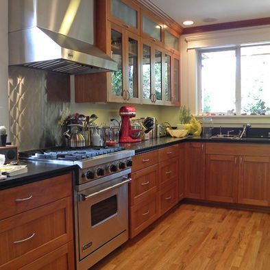 Medium tone wood cabinets with glass front upper cabinet for Kitchen ideas for medium kitchens