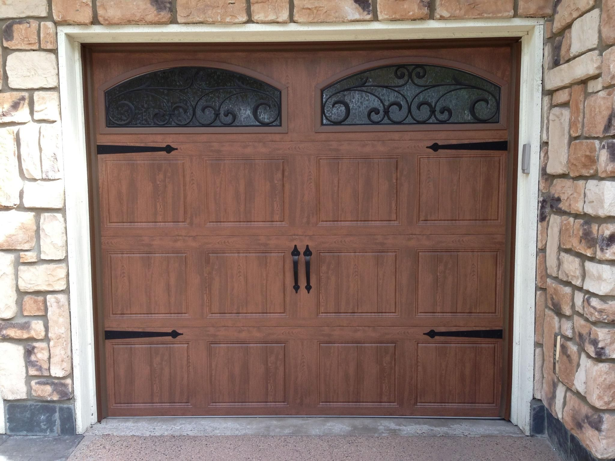 Clopay walnut finish Gallery Collection garage doors with arched
