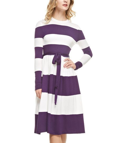 Exude head-turning style in this chic dress flaunting a cozy construction and bold print.