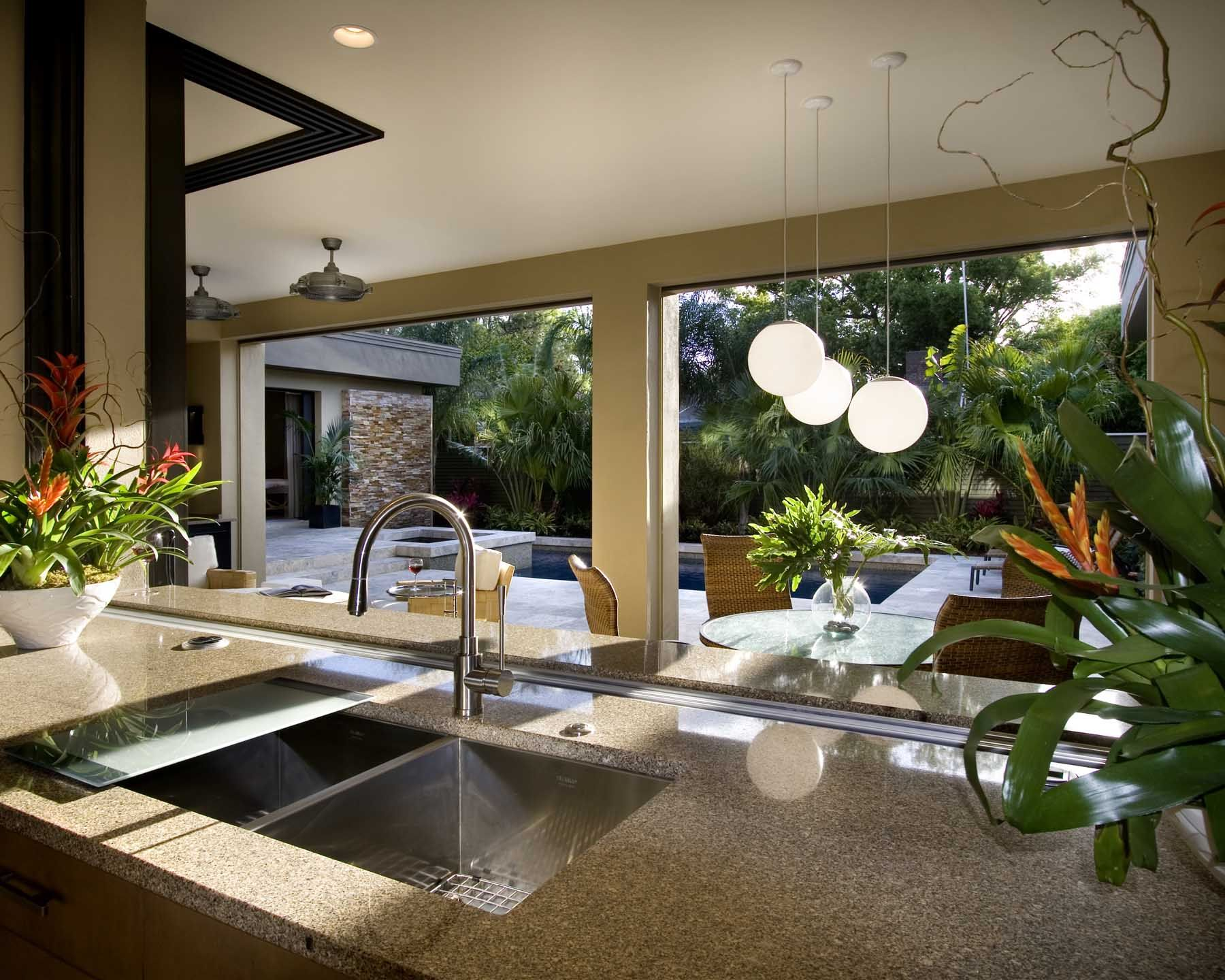 Kitchen with pocketing windows, a pass through to outdoor ... on Outdoor Kitchen Living Spaces id=46709