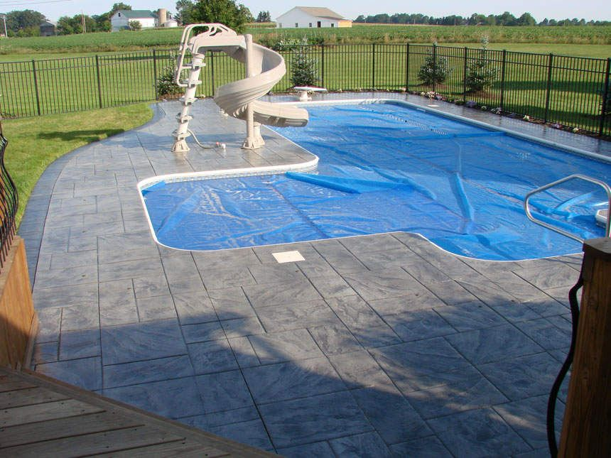 Stamped concrete walkway around an outdoor pool lap of - Stamped concrete walkway ideas ...