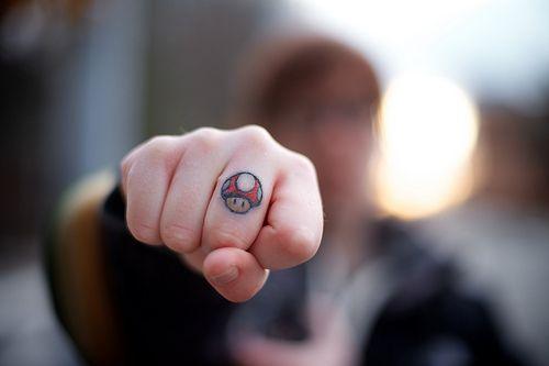ccf95d328 Pin by Tattoo Ideas on <<FINGER TATTOOS>>   Mario tattoo, Super ...