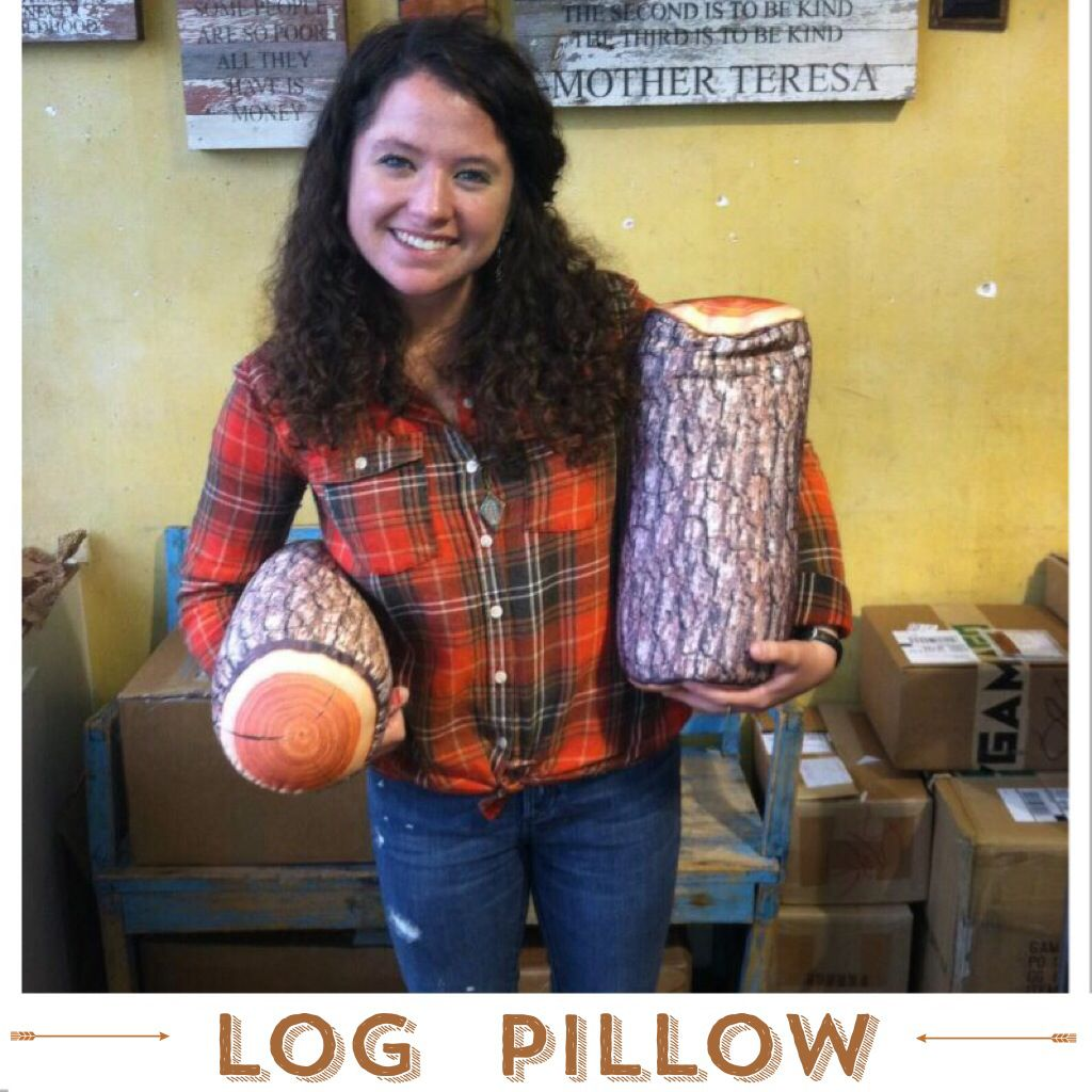 Lumber jack Allie with our new Log Pillows.  Now you can saw logs on the couch all weekend appropriately with a rustic and realistic-looking pillow with contouring micro-bead fill. *Much safer for pillow fights than actual logs.$18.95