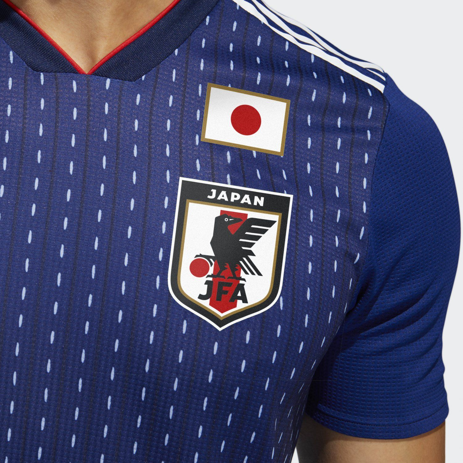 5fb36c8be The Adidas Japan 2018 World Cup home kit introduces a clean look with a  stripe pattern on the front.
