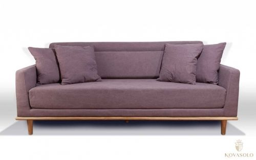 Moderne og delikat New Amsterdam sofa med pynteputer inkludert. Sofaen har understell i eik og et holdbart og varig
