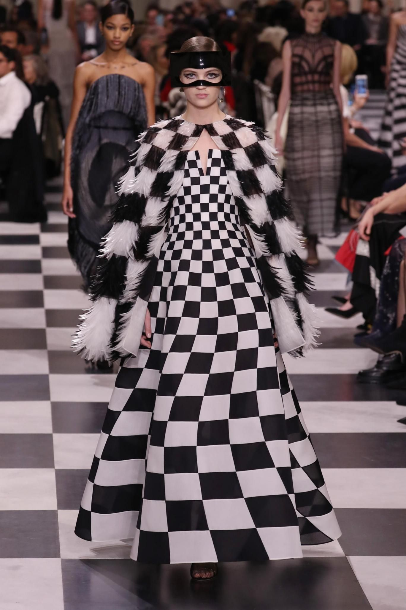 37d856d901 Dior catwalk in Paris today 2018 as Maria Grazia Chiuri unveiled her latest  Dior couture collection as an ode to Surrealism. Chess dress.