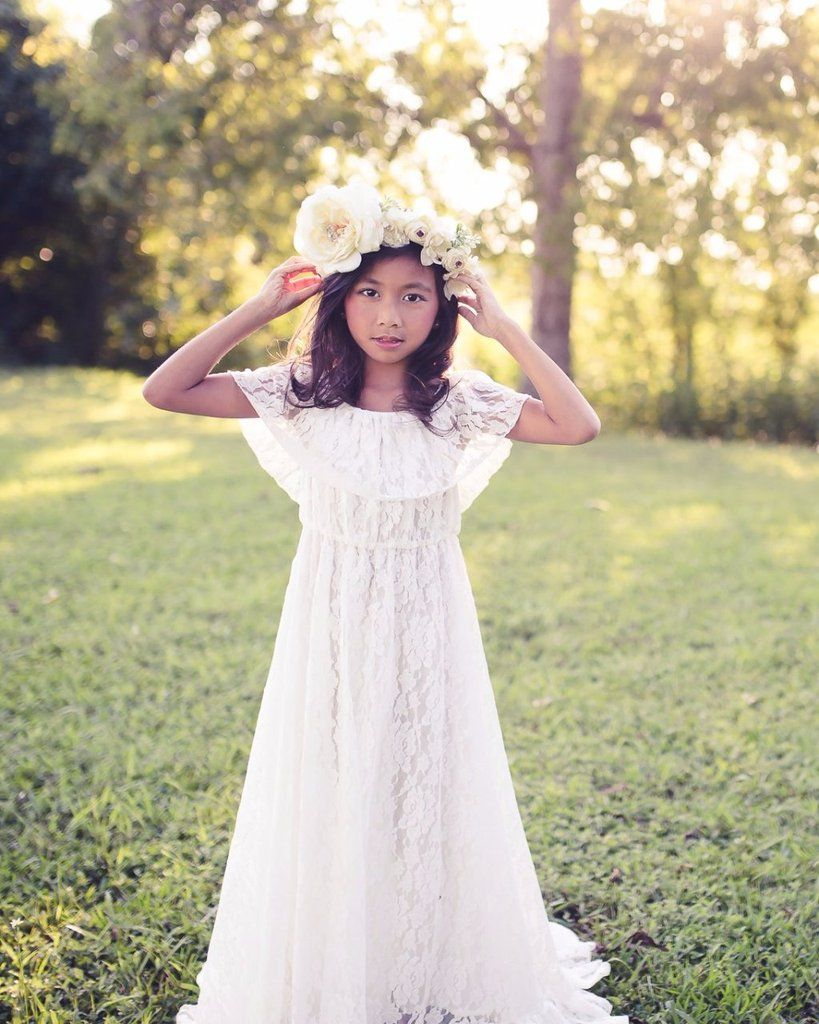 10f6a2b56364 This off shoulder lace dress is simple, elegant and the perfect flower girl  dress for a boho weddding.