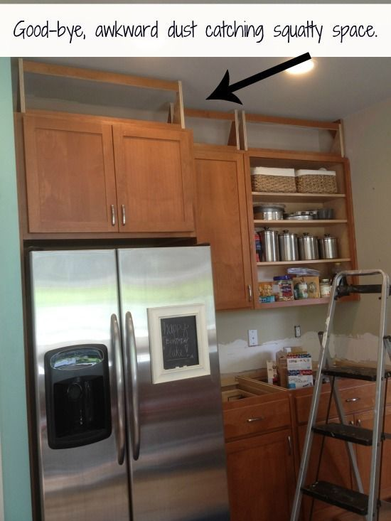 A Great Idea For Getting Rid Of The Empty E Above Kitchen Cabinets