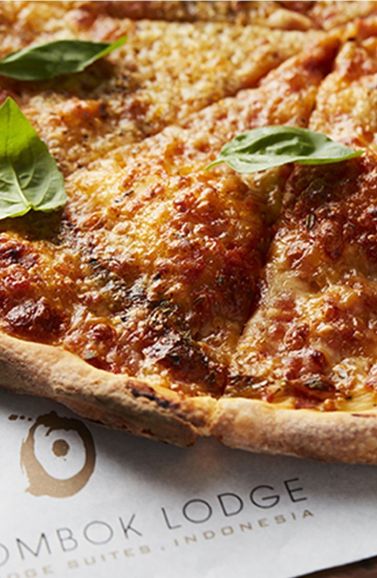 Chef jiwas pizza is prepared with love baked in a stone