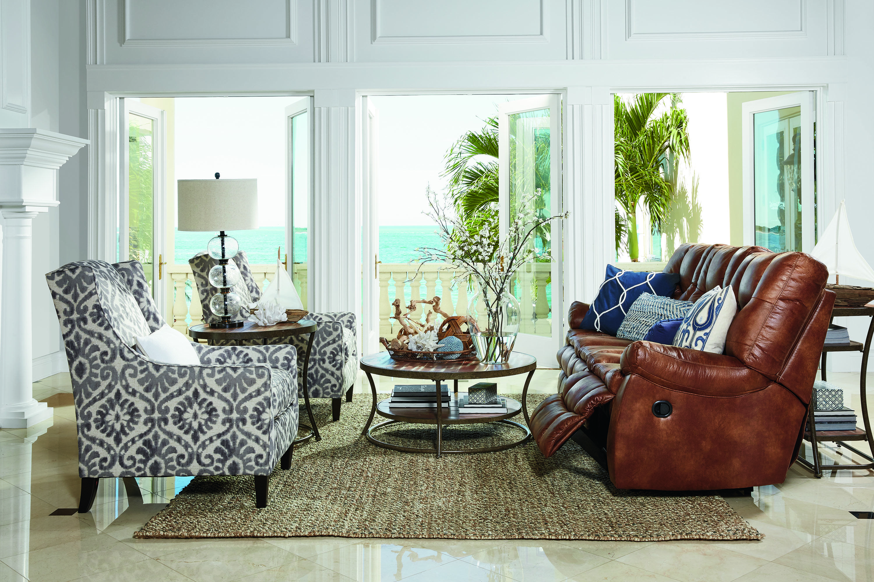 We are loving this reclining sofa paired with the accent chairs