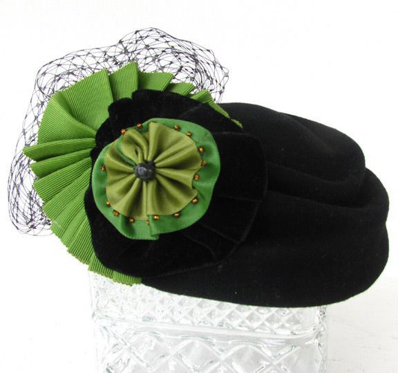 Black cocktail hat with ribbon embellishment. #cocktail #hat #fascinator # whimsy #black #green