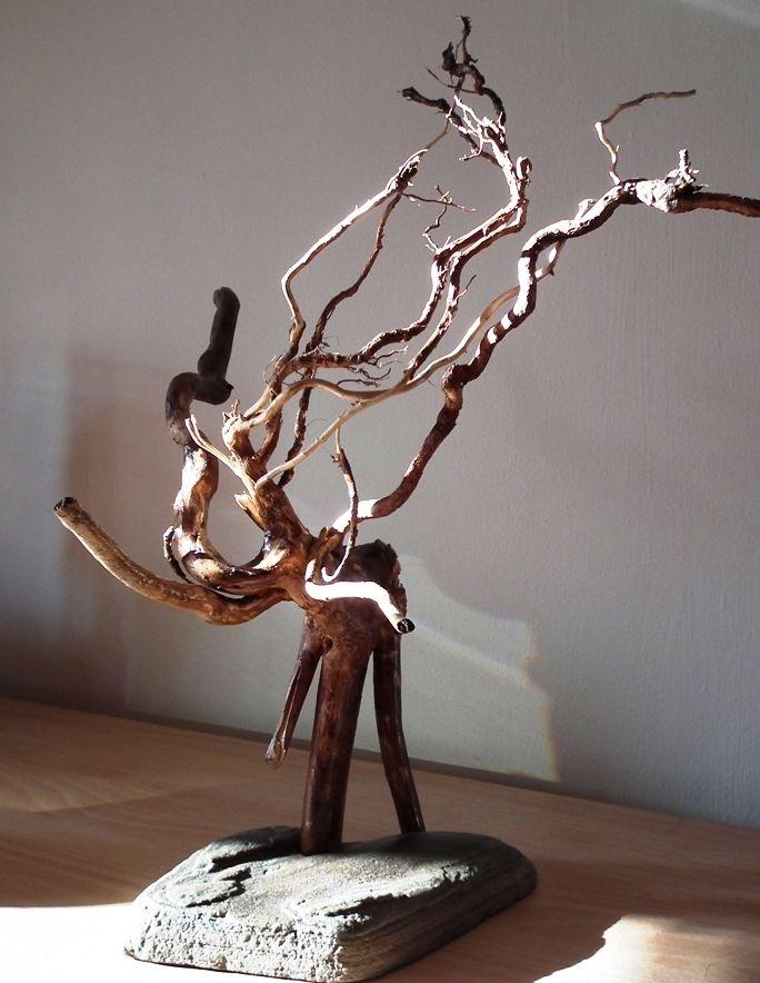 LE MAMMOUTH (fait de bois-racine et  pierre)