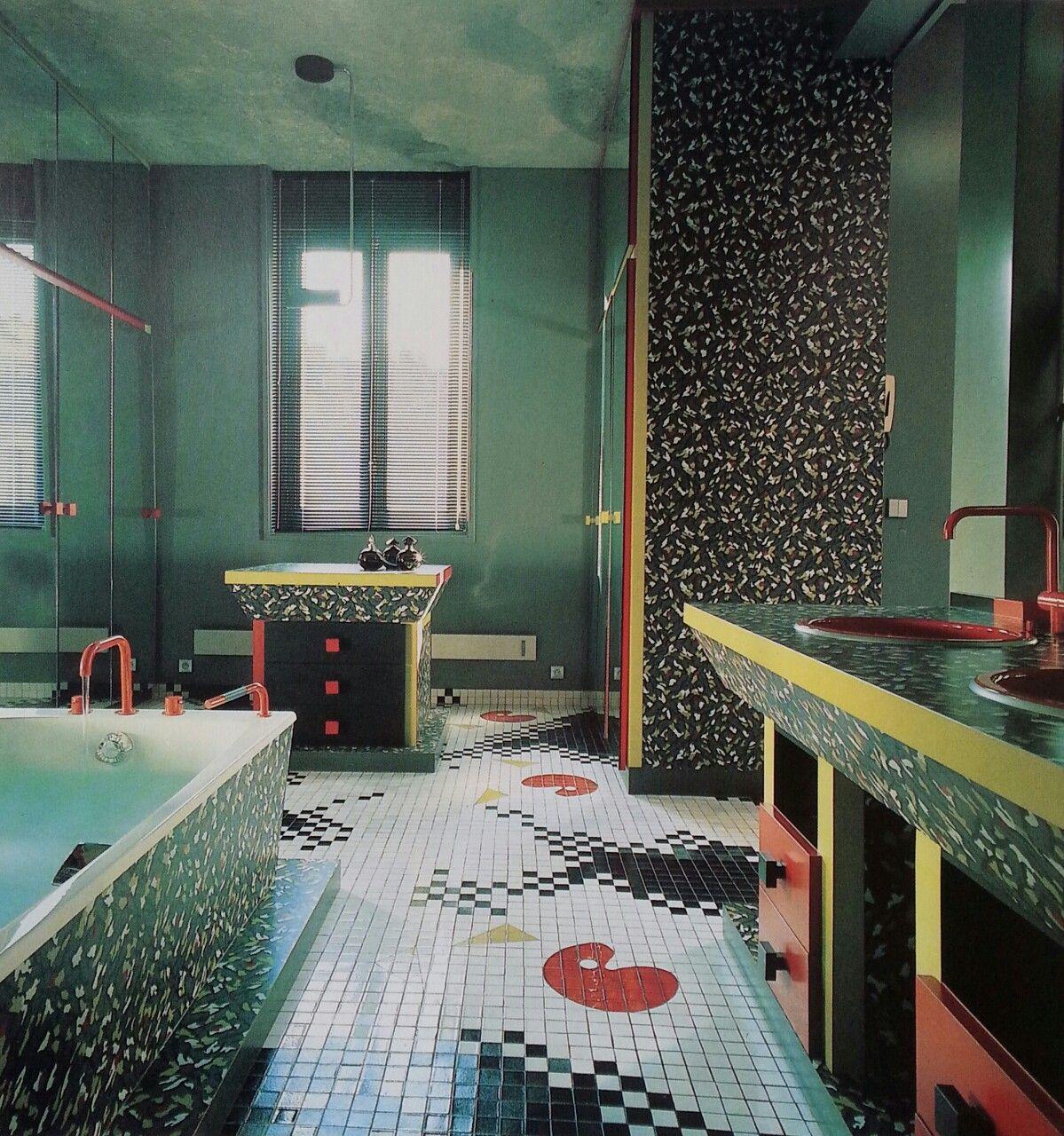 Patterned Laminate PoMo Bathroom, Mirrored Cabinets, Red Fixtures, Pixelated Splatter Tile Floor