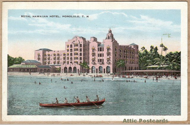 Vintage postcard of the Royal Hawaiian Hotel in Honolulu, Hawaii. Shows an Shows the hotel, beach and an outrigger canoe.