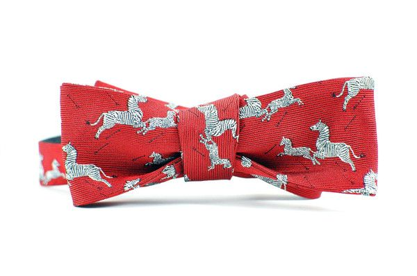 Zebra Bow Tie in Red $62.00   Woven from one of the oldest English mills, this 100% silk tie was created in partnership with the world-famous brand Scalamandre, using their iconic Zebra pattern. Scalamandre's iconic Zebra pattern dates to late 1930s New York, premiering at Gino's restaurant on Lexington Avenue. Flora Scalamandre designed it especially for Gino's owner, Gino Circiello.  Made in New York City