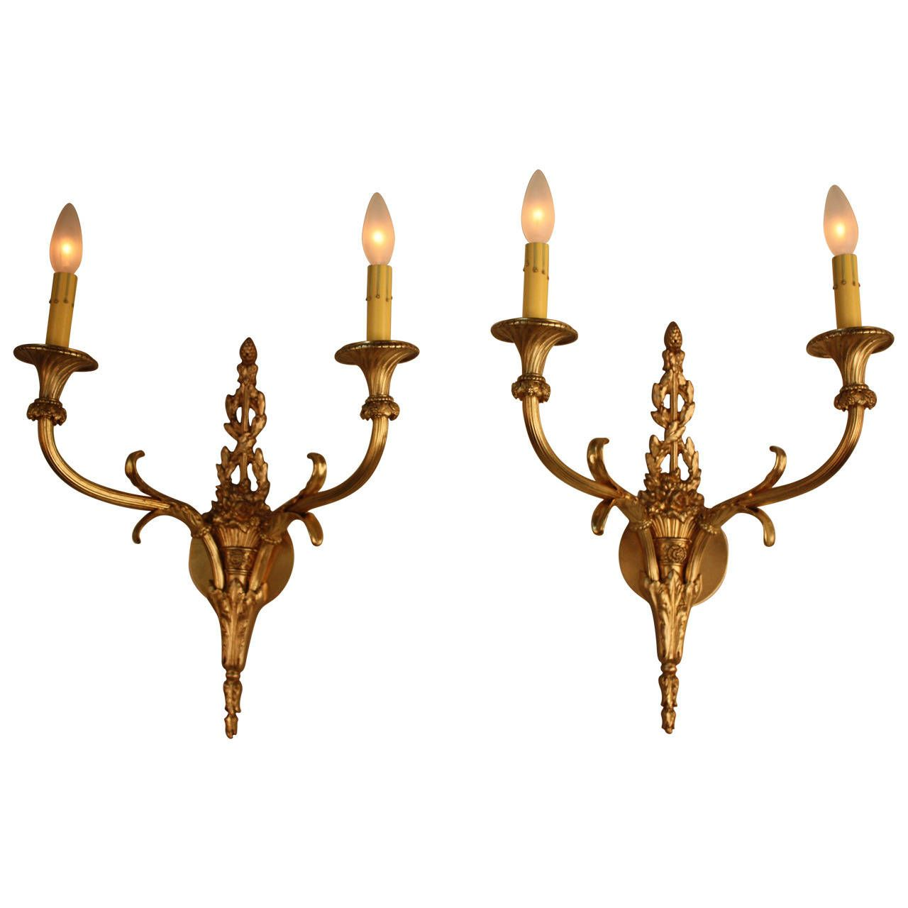 A pair of exquisite antique French bronze wall scones. Each sconce features a double-light and superb workmanship.