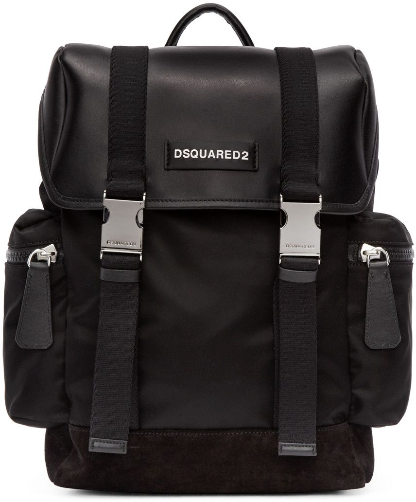 a55cf8d1d6 Structured nylon backpack in black. Carry handle at top. Adjustable padded  shoulder straps. Logo plaque at face. Zippered compartment at sides.