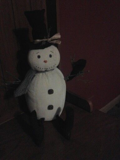 Snowman with a winter crow