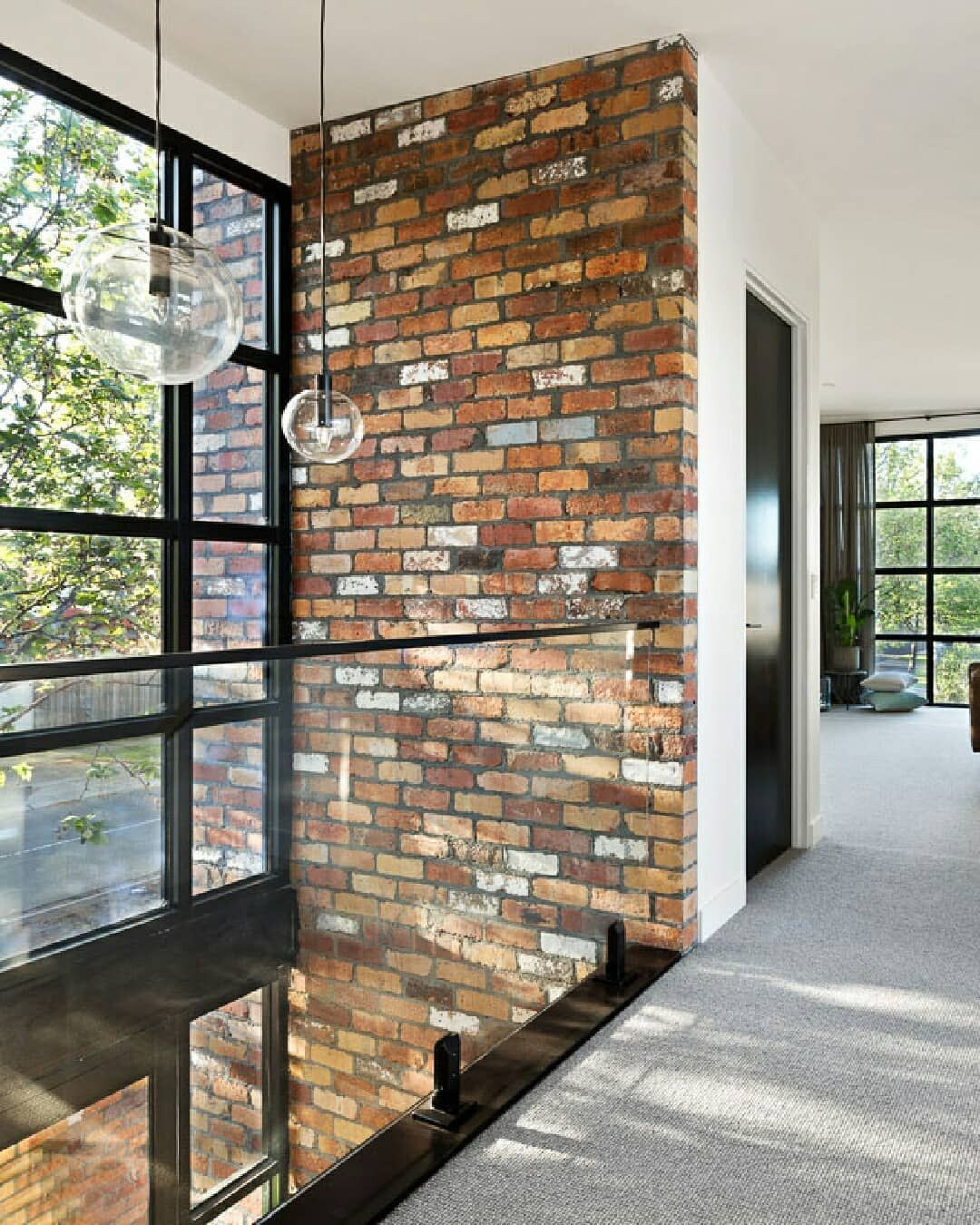 Double Height Recycled Brick Wall Glass Balustrade And Statement Windows In This Retreat Space In 2020 Recycled Brick Brick Wall Glass Balustrade