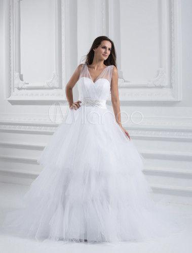 vestido de novia de tul con tirantes y cuentas de cola larga