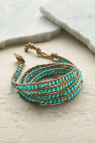 In a rustic handmade look, our Solana Wrap Bracelet features turquoise and shimmering golden beads.