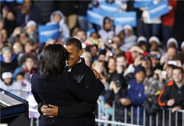 U.S. President Barack Obama hugs First Lady Michelle Obama before he addresses supporters on last night of campaign in a downtown Des Moines, Iowa, rally, November 5, 2012. REUTERS/Larry Downing via | http://elections.reuters.com/liveblog#page/last/post/55678090