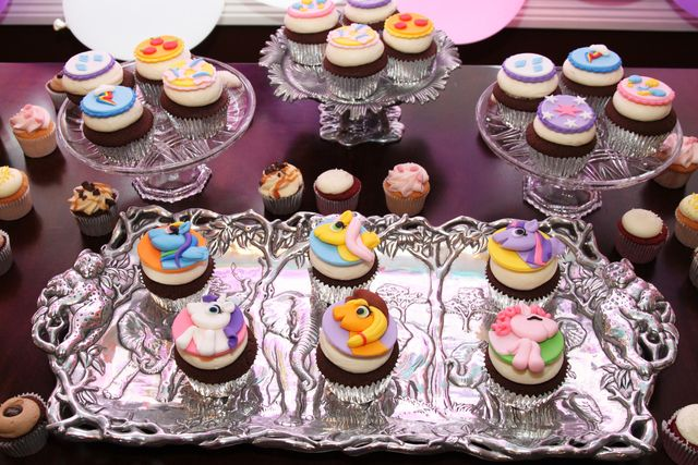 Fondant topped cupcakes and cookies at a My Little Pony Birthday Party!  See more party ideas at CatchMyParty.com!   #partyideas #mylittlepony