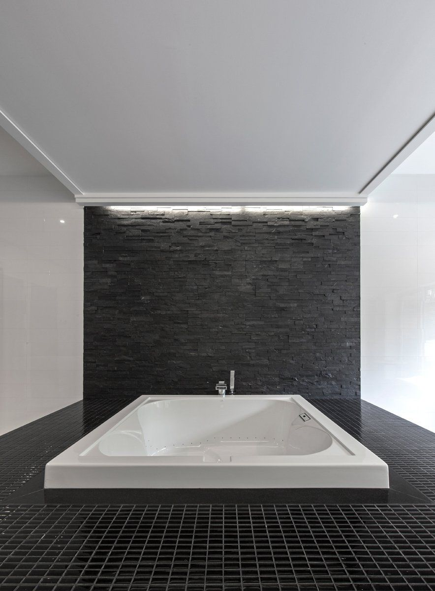 Luxurious Master Bathroom Tub Idea In Light White With Grey Stone Background Idea To Match Dark Tiled Floor