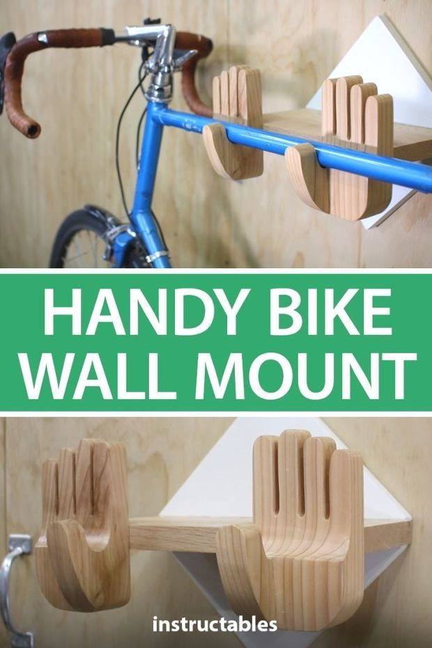 This simple wooden bike rack is shaped like two hands that will hold up your bike with thumbs