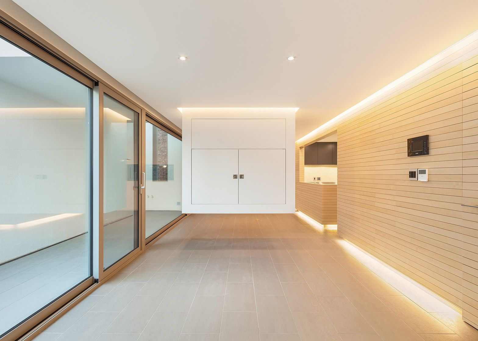 Deep set windows maintain privacy for gangnam residence by obba