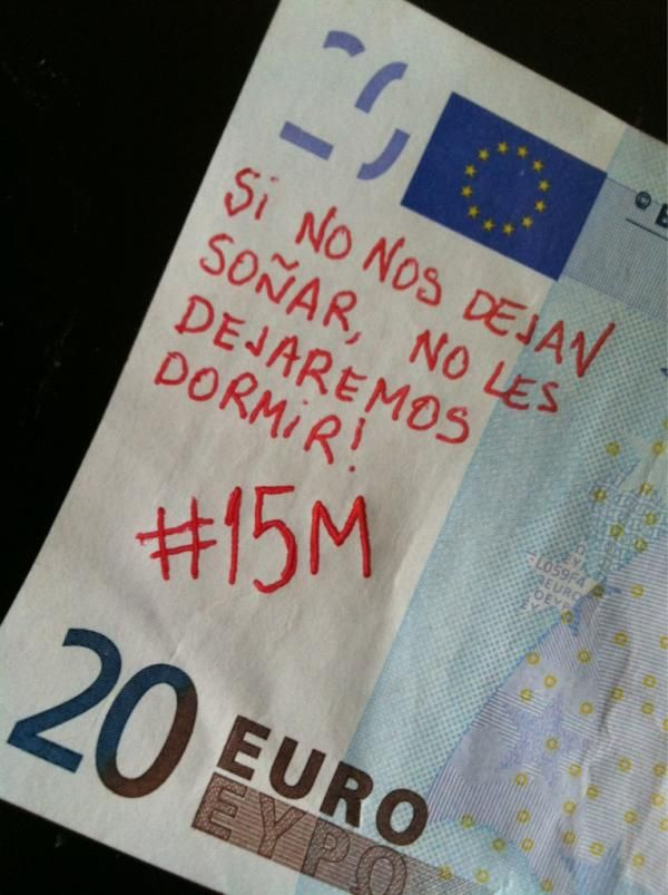 """Translation: """"If they don't let us dream, we won't let them sleep. #15M Spain"""""""