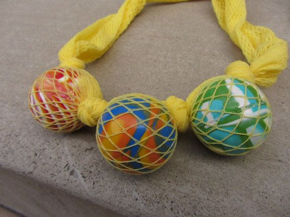 Repurposed Bouncy Rubber Balls Necklace in Fishnets Casing - Bold Colors - Womens Upcycled Clothing. $14.00, via Etsy.
