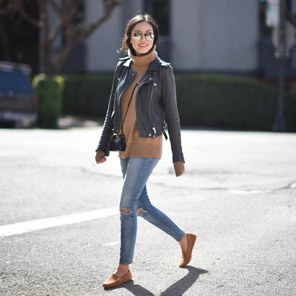 A sleeveless sweater paired with a leather jacket, jeans, and loafers on  blogger 9