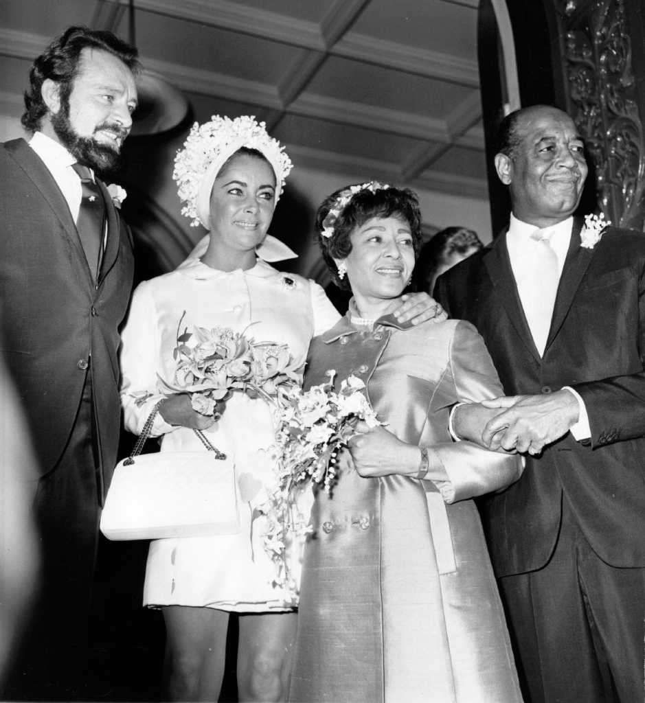9th August 1969:  The Welsh actor Richard Burton (1925 - 1984) and his wife, actress Elizabeth Taylor, at the wedding of Burton's personal assistant Robert Wilson and Gladys Mills, at Caxton Hall, London. Photo: Michael Webb, Getty Images / Hulton Archive