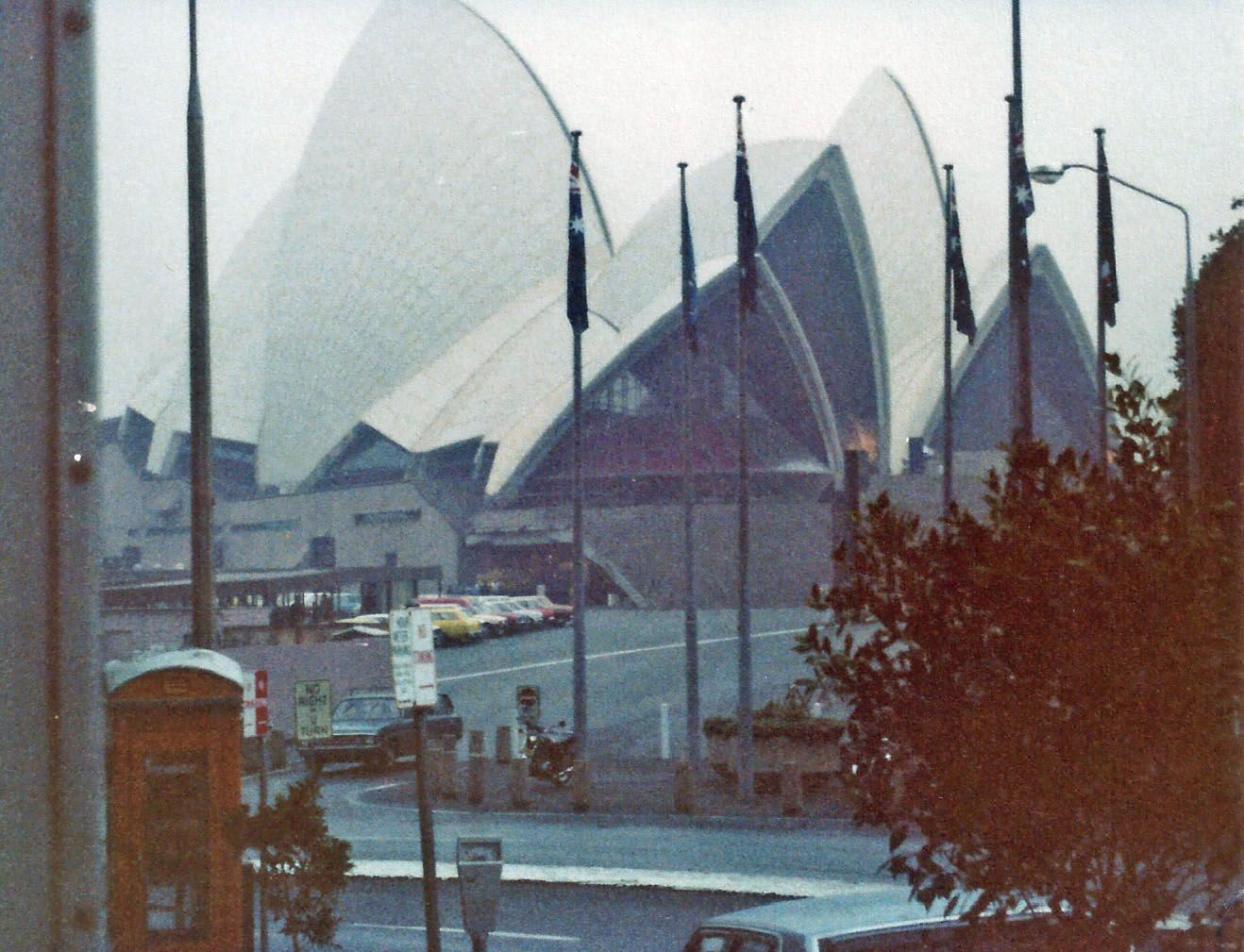 Overcast day while driving by the Opera House in Sydney, Australia.  May 1980.  Queen Elizabeth was visiting the area so we were unable to get any closer to the opera house that day due to security.