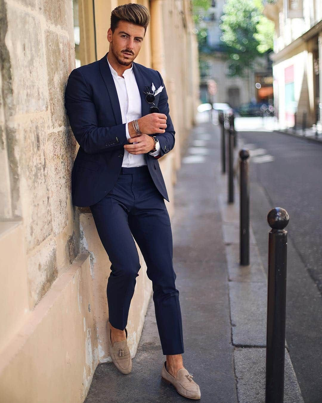 Dark blue suit, mandarin collar white shirt, and loafers