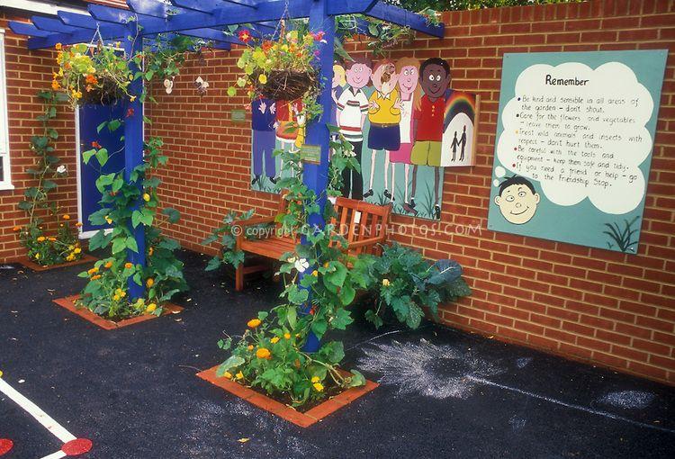 elementary school garden in concrete with brick building mural playground climbing vines