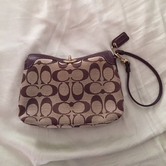Large Coach wristlet Large Coach signature wristlet with turn-lock clasp. Slight staining on interior pocket. Coach Bags Clutches & Wristlets