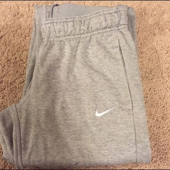 NIKE THERMA-FIT Sweatpants Fleece lined with pockets and zippers at bottom but no elastic around the ankles Nike Pants Track Pants & Joggers