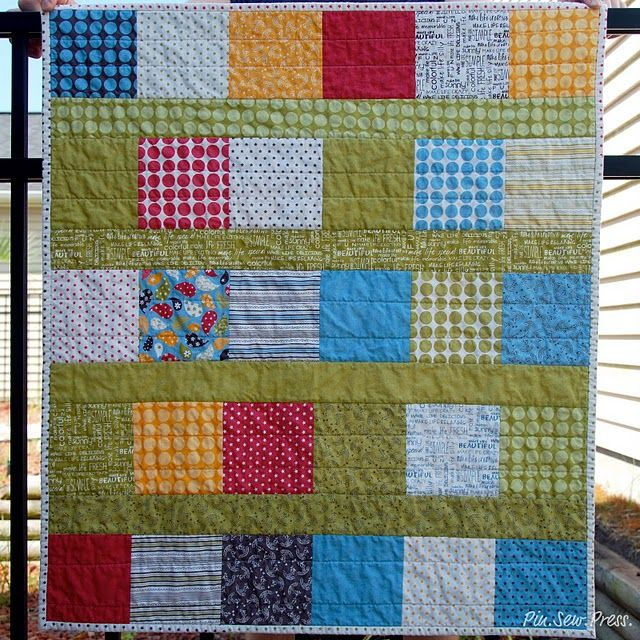 """Good beginner quilt. 6"""" squares with strip in between rows."""