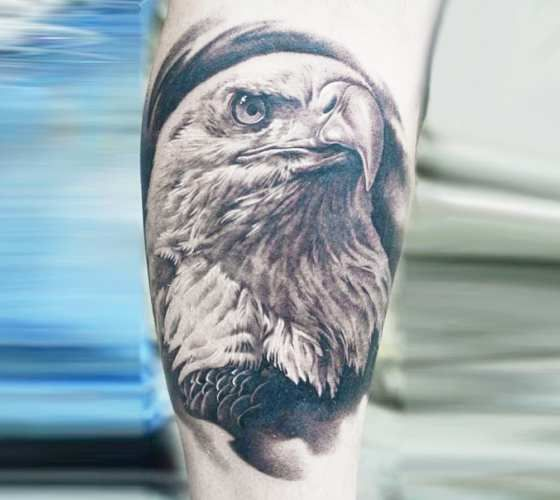 Nice realistic black and gray Eagle head tattoo art done by artist A.D. Pancho